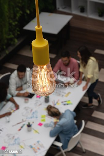 istock Light bulb at a creative office 1021336812
