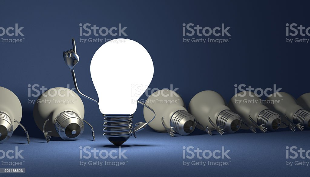 Light bulb character, aha moment  on blue Glowing light bulb character in moment of insight standing among many switched off lying ones on blue textured background American Heart Association Stock Photo
