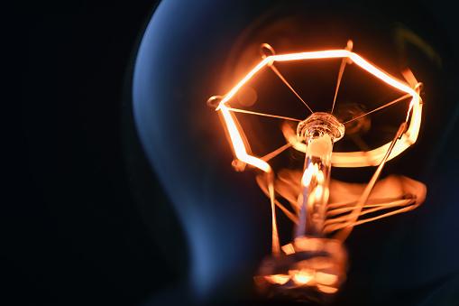 Close up glowing light bulb