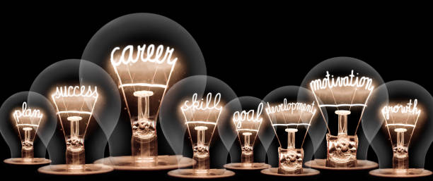 Light Bulb Concept Photo of light bulb with shining fibers in shapes of CAREER concept related words isolated on black background aptitude stock pictures, royalty-free photos & images