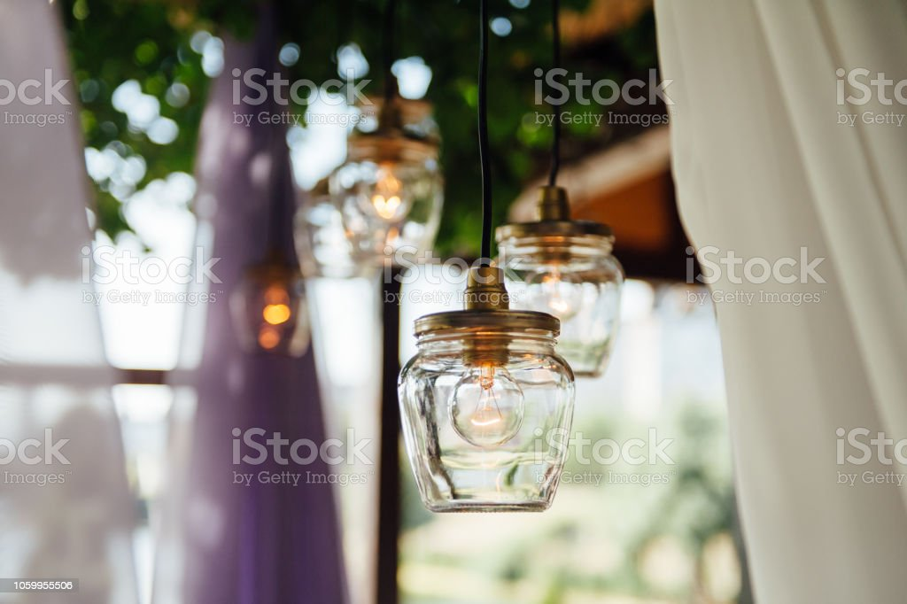 Light Bulb Decor In Outdoor Wedding Ceremony Stock Photo - Download