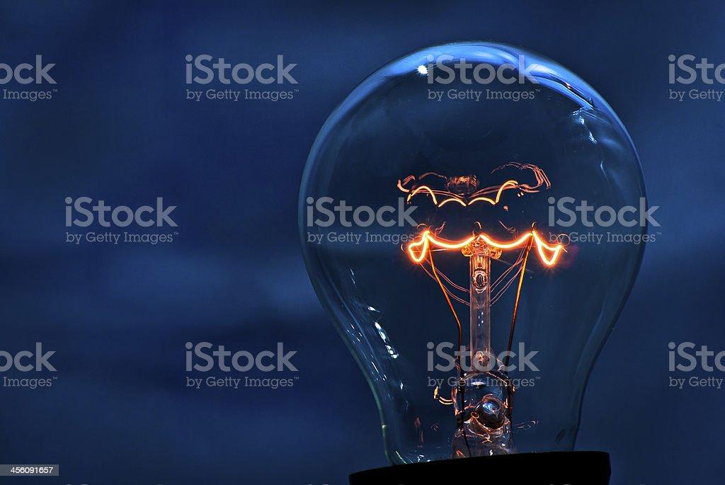 Light bulb deep blue stock photo
