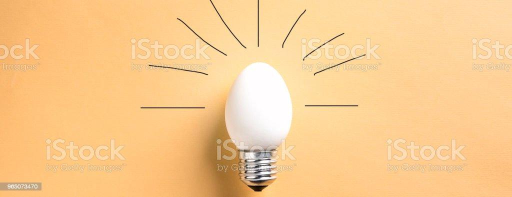 Light Bulb Egg shell on Base Concept  Energy Saving royalty-free stock photo