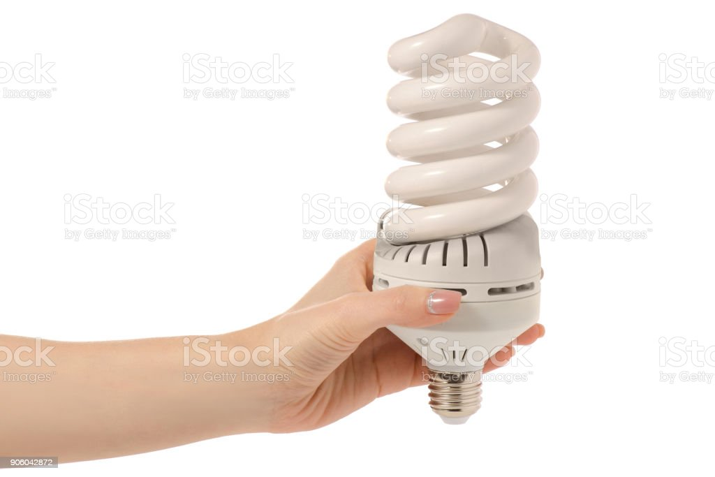 Light bulb energy saving in hand stock photo