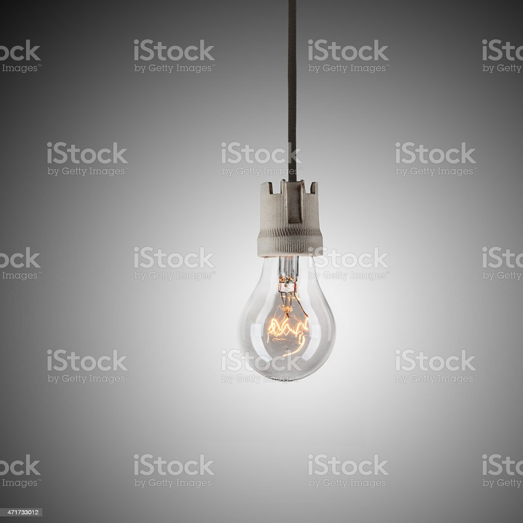 Light Bulb Hanging On Wire stock photo | iStock