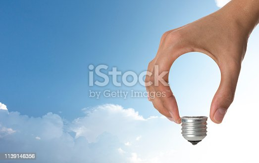 Light bulb in human hand.