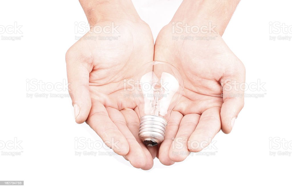 Light bulb in the hand royalty-free stock photo