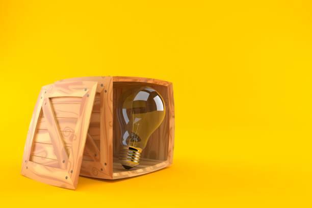 Light bulb inside cargo crate - foto stock