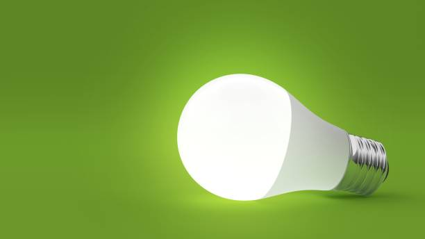 light bulb isolated on green background. 3d illustration - światło led zdjęcia i obrazy z banku zdjęć