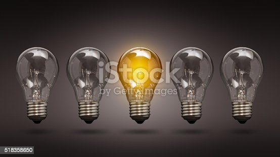 578276932 istock photo Light bulb lamps on a colour background. 518358650