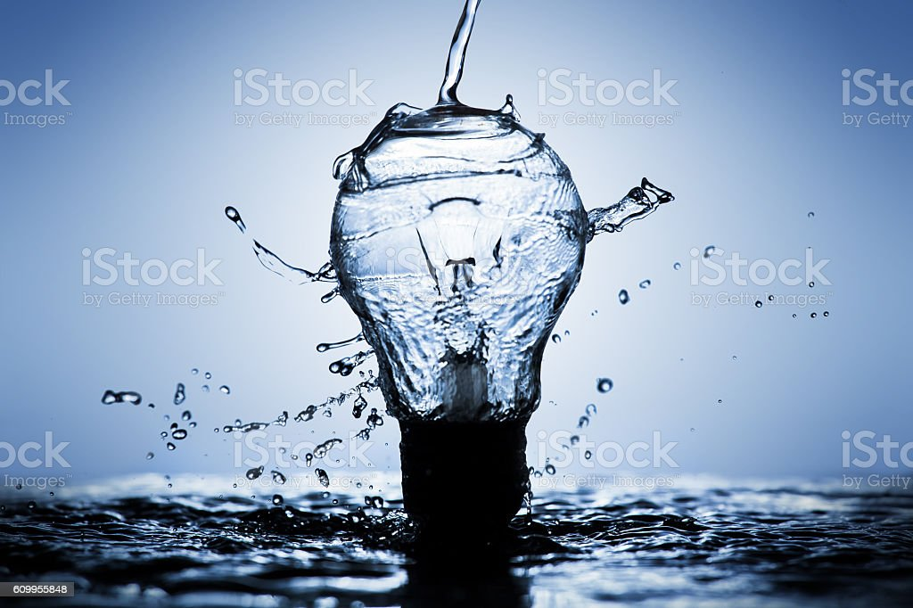 Light bulb made of water splashes stock photo
