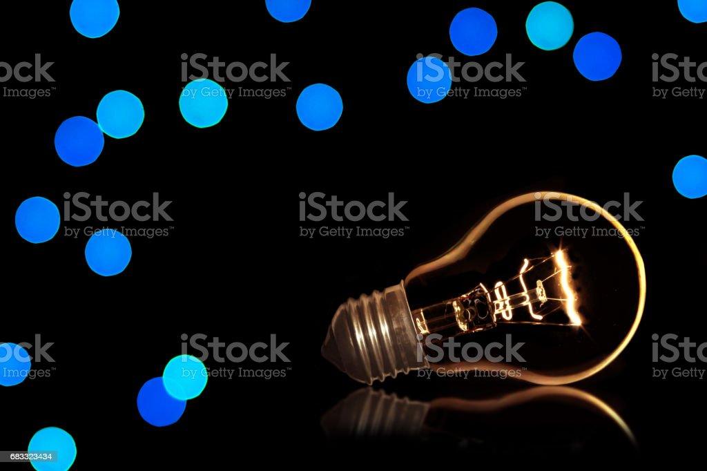 Light bulb on a black background royalty-free stock photo