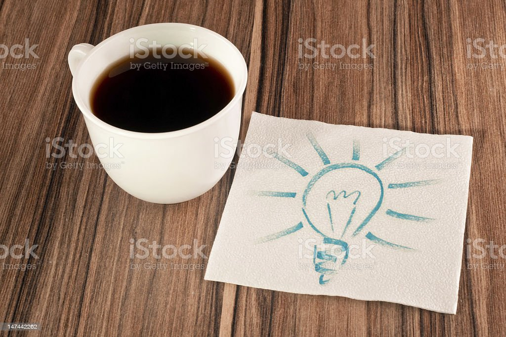 Light bulb on a napkin royalty-free stock photo