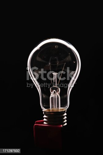 istock Light bulb on black background 171297532