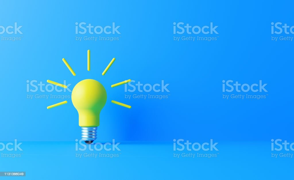 Light bulb on blue background. Horizontal composition with copy...