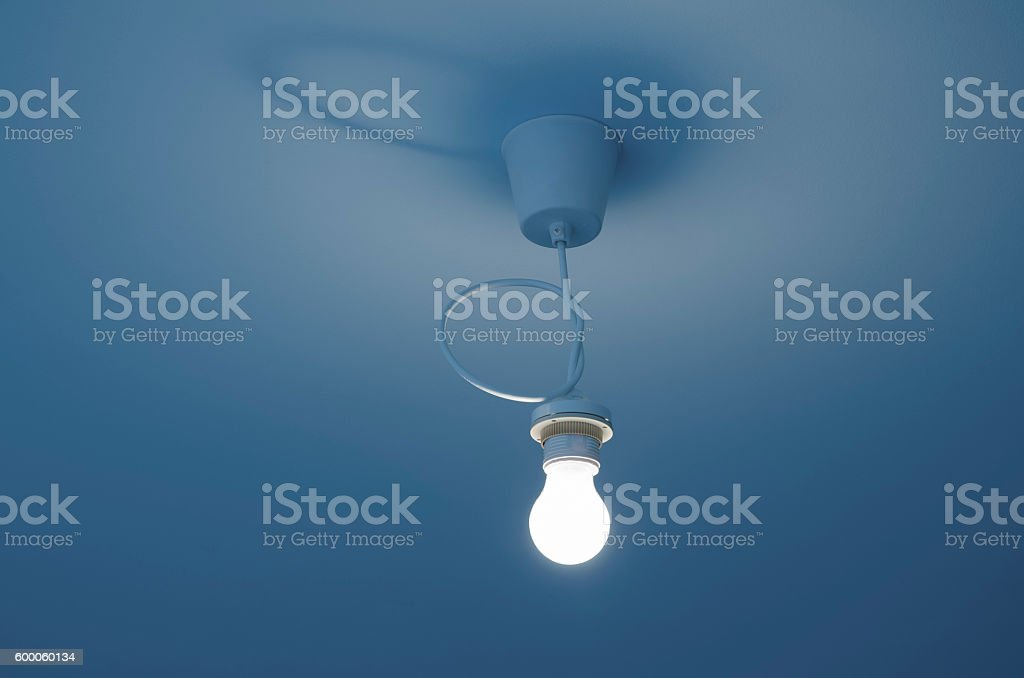 light bulb on ceiling stock photo