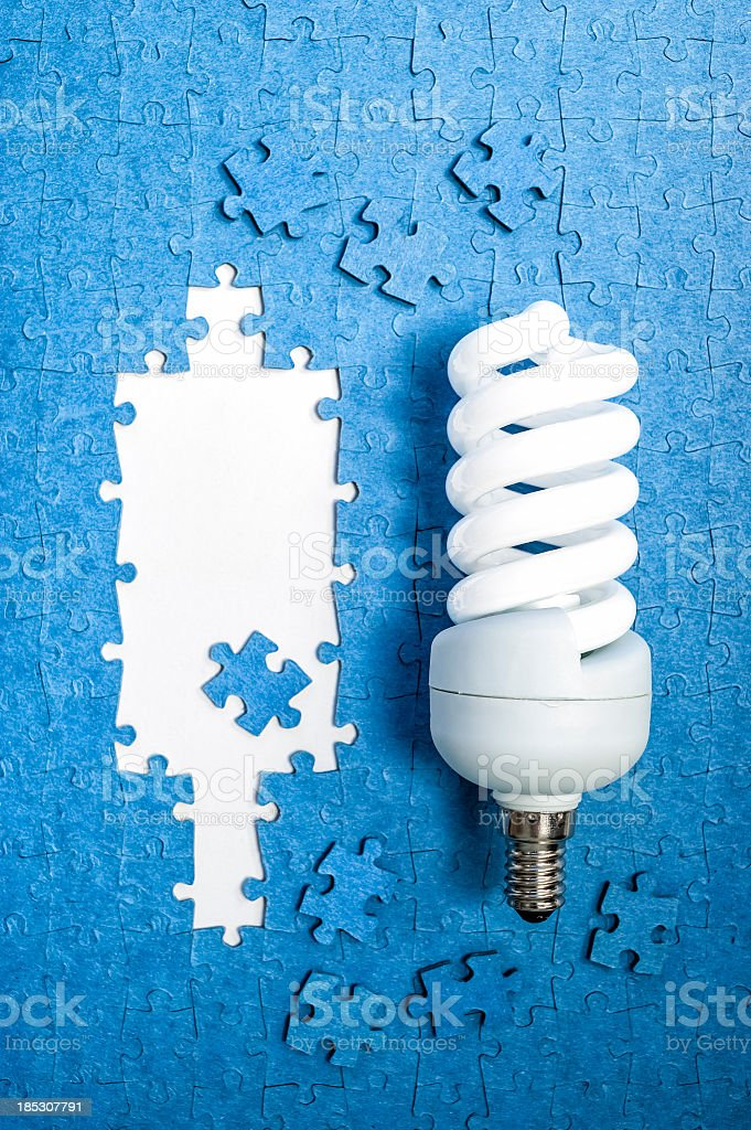 Light Bulb On Jigsaw Puzzle royalty-free stock photo