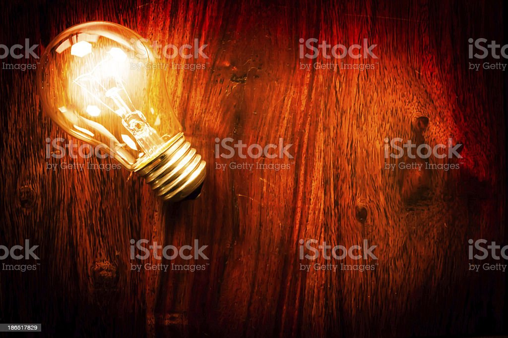 Light bulb on table royalty-free stock photo