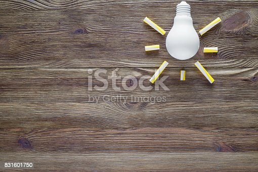 istock Light bulb on the wooden background, flat lay. 831601750