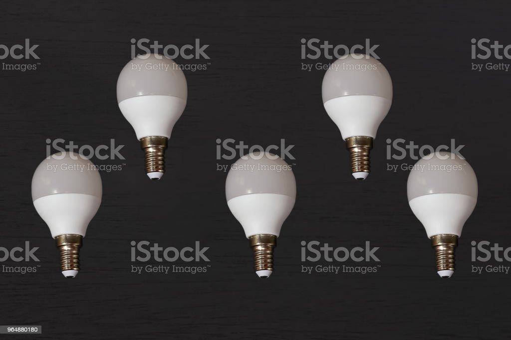 Light bulb on wood royalty-free stock photo