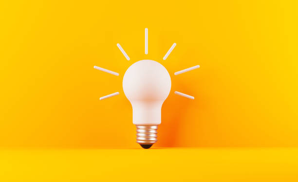 Light Bulb On Yellow Background Light bulb on yellow background. Horizontal composition with copy space. Creativity and innovation concept. ideas stock pictures, royalty-free photos & images