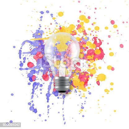637797672istockphoto Light bulb over multicoloured painting drops 920064042
