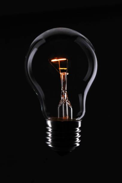 light bulb. - low lighting stock photos and pictures