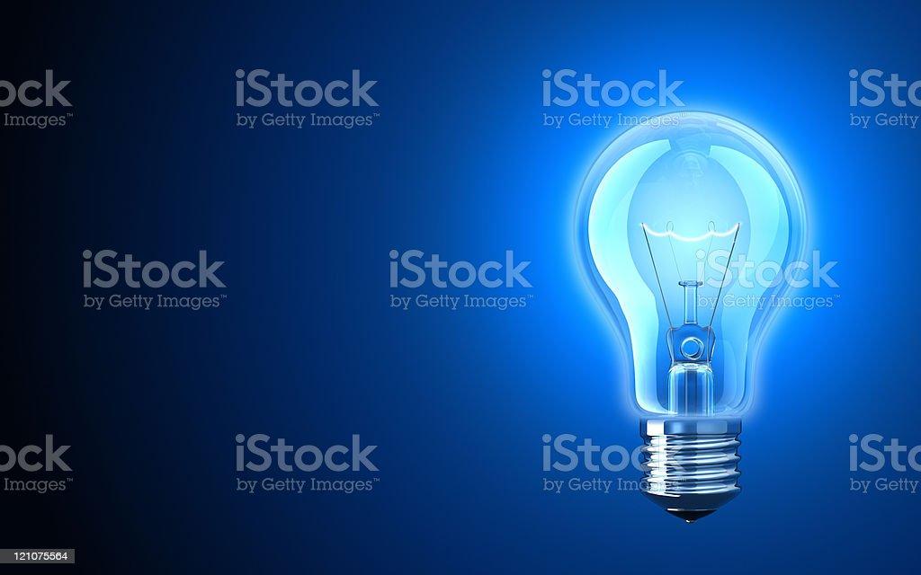 Light bulb providing blue light stock photo