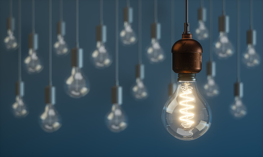 Light Bulb Standing Out From the Crowd Concepts
