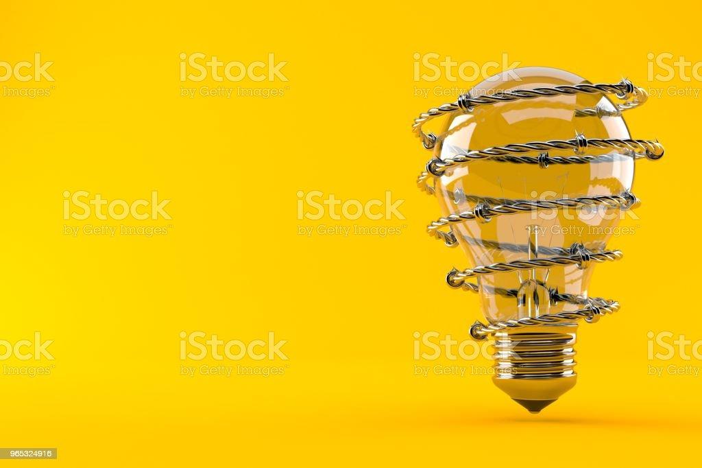 Light bulb with barbed wire zbiór zdjęć royalty-free