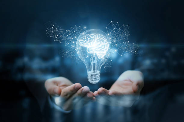 Light bulb with brain inside the hands of the businessman. stock photo