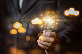 Light bulb with brain the hands of the businessman. The concept of the business idea.