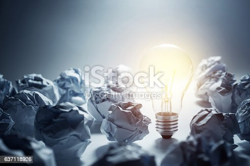 istock Light Bulb with crumpled paper ball.Business ideas 637118926