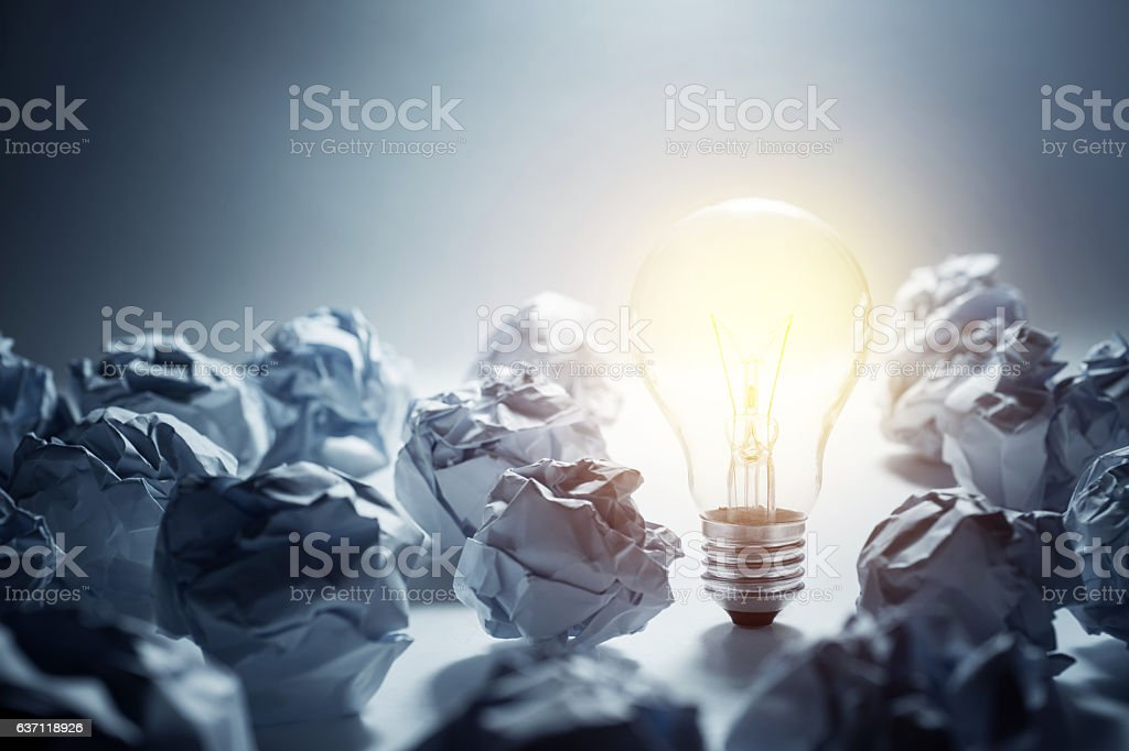 Light Bulb with crumpled paper ball.Business ideas stock photo
