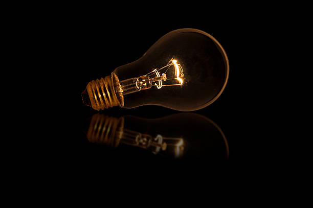 light bulb with dim lighting without wired - low lighting stock photos and pictures