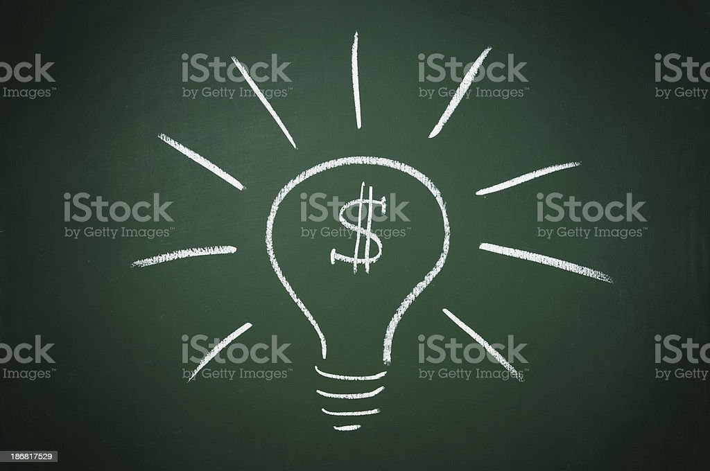 light bulb with dollar sign drawn on a blackboard stock photo