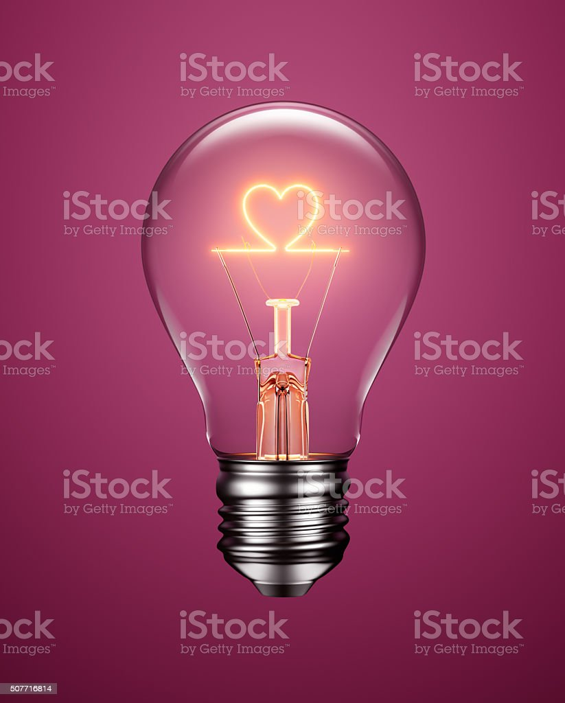 Light Bulb with Filament Forming a Heart Icon stock photo