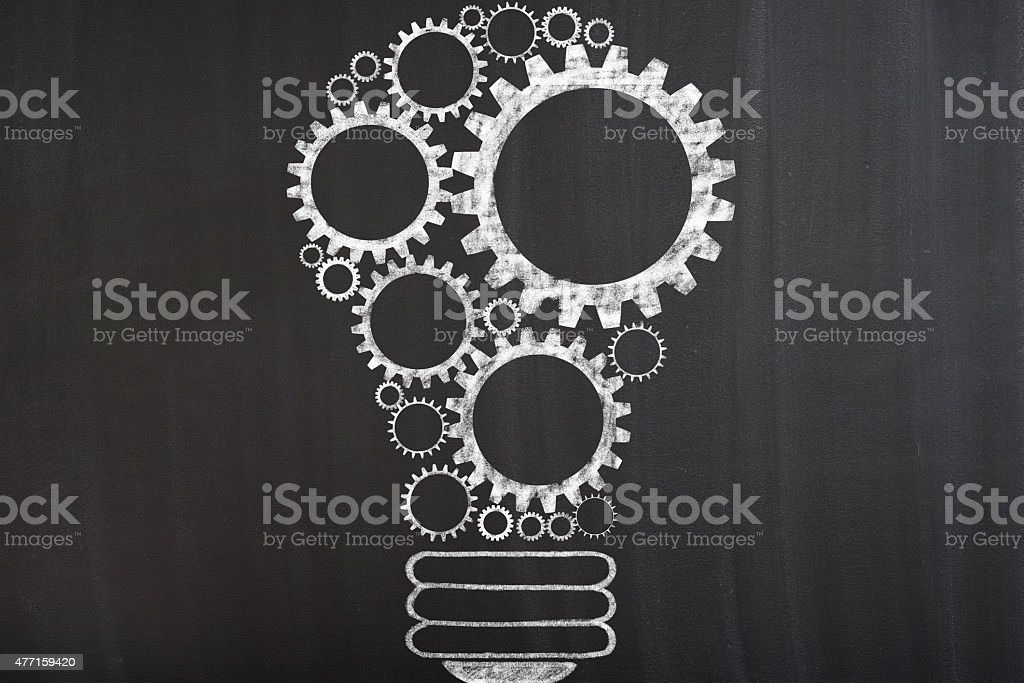 Light bulb with gears stock photo