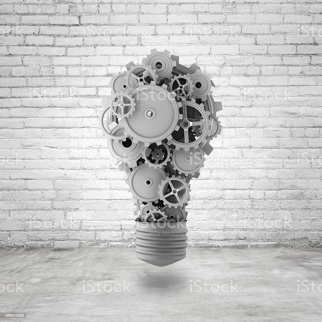light bulb with gears light bulb with gears and cogs in brick room Brick Stock Photo