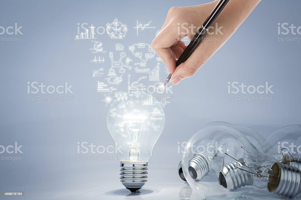 Light bulb with hand drawing graph stock photo