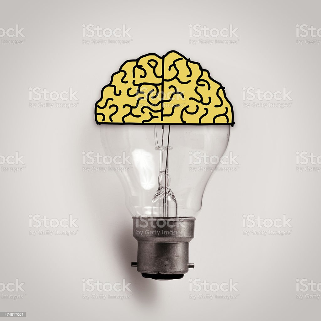 Light bulb with hand drawn brain as creative idea concept royalty-free stock photo
