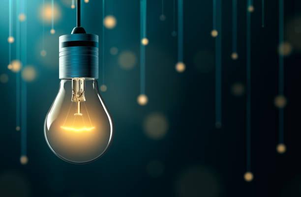 żarówka z tłem ze światłami wiszącymi - elektryczność zdjęcia i obrazy z banku zdjęć