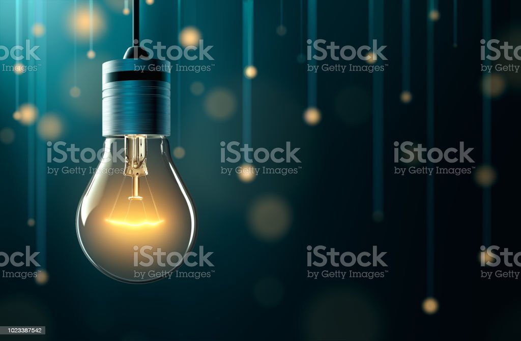 Light bulb with hanging lights background stock photo