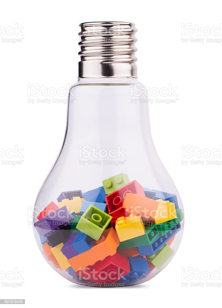 light bulb with many toy colored construction blocks inside stock photo