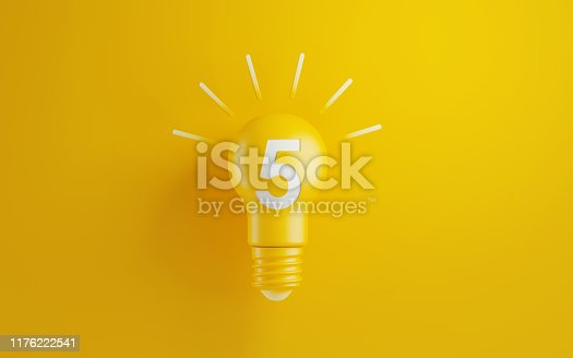 Light bulb on yellow background. Number five writes on the lightbulb. Horizontal composition with copy space. Creativity and innovation concept.