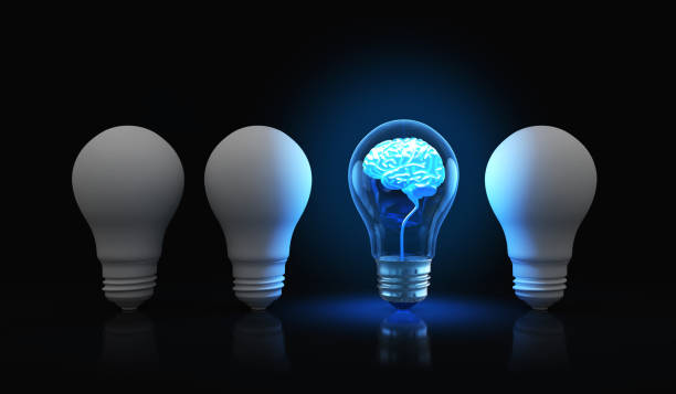 Light bulb with shining brain inside stock photo