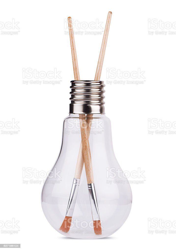 light bulb with two painting brushes inside on white stock photo