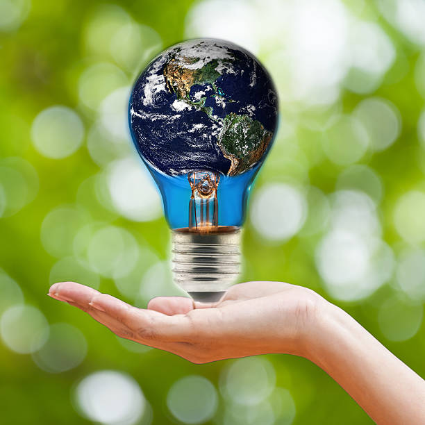 light bulb with world inside Elements by Nasa stock photo