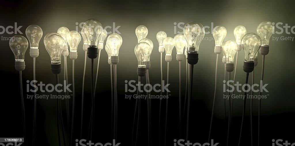 Light Bulbs Aiming Skyward With Eerie Glow stock photo