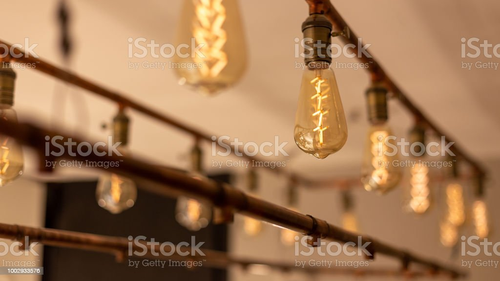Light bulbs hanging from the ceiling. Vintage style stock photo